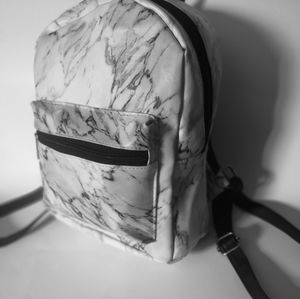 Euc Ardene Small marble stamped bag pack